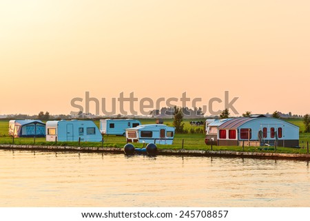 Dutch camping site in the province of Friesland during sundown - stock photo