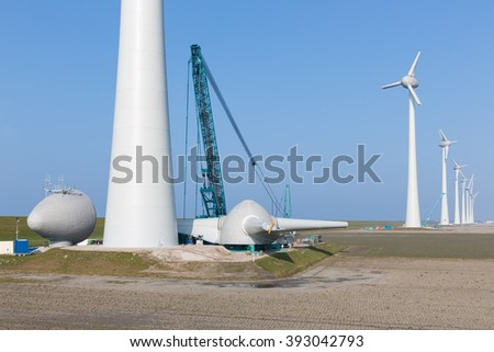 Dutch farmland with construction site new wind turbine farm - stock photo