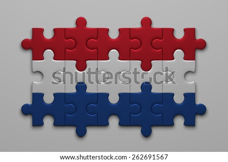 Dutch flag assembled of puzzle pieces on gray background - stock photo
