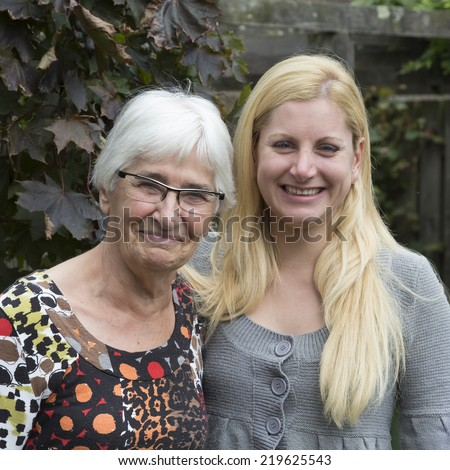 Dutch grandmother and her granddaughter - stock photo
