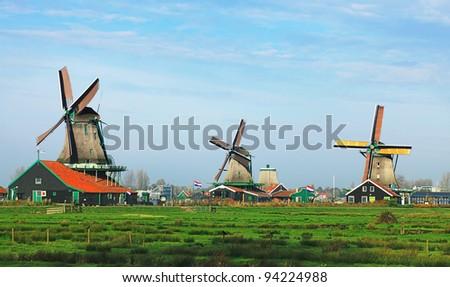 Dutch landscape with traditional windmills in Zaanse Schans. - stock photo