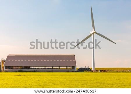 Dutch modern farmhouse with wind turbine - stock photo
