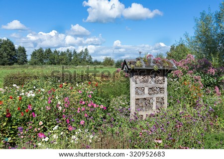 Dutch national park with an insects hotel in a colorful garden - stock photo