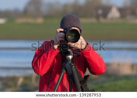 Dutch nature photographer (Eemnes, the Netherlands) - stock photo