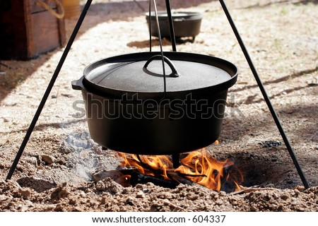 Dutch oven cooking over an open flame - stock photo
