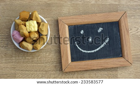 Dutch Pepernoten and a smile, typical Dutch treat for Sinterklaas on 5 december - stock photo