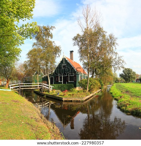 Dutch typical house and water canals traditional landscape, Zaanse Schans,Netherlands  - stock photo