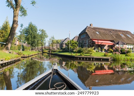 Dutch village Giethoorn with water and bridges - stock photo