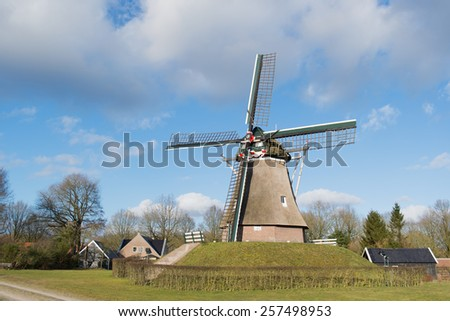 Dutch windmill in little village Aalden in Drenthe - stock photo