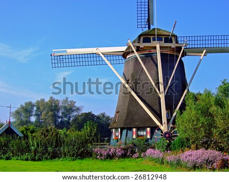 dutch windmill, windmill next to the rembrandt-statue just outside amsterdam - stock photo