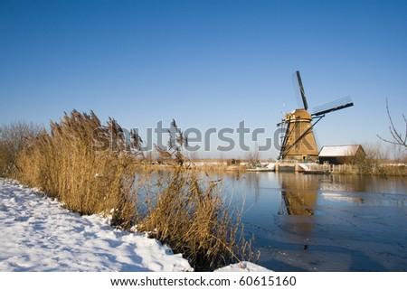 Dutch winter with windmill - stock photo