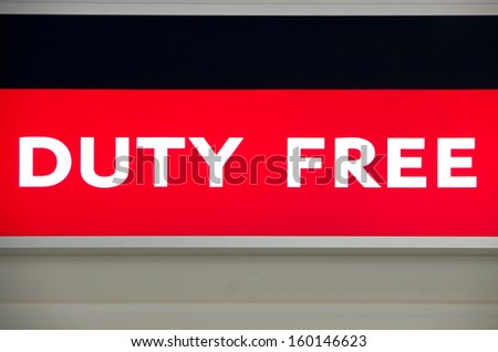 Duty free illuminated sign on an airport - stock photo
