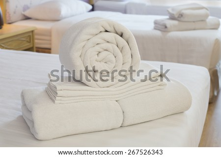 Duvet roll. down filled duvet rolled up isolated on white background - stock photo