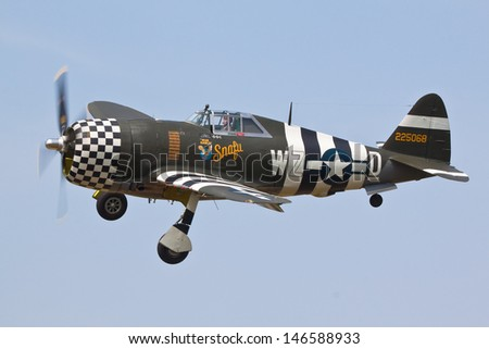 "DUXFORD, CAMBRIDGESHIRE, UK - JULY 14: Republic P-47G Thunderbolt ""SNAFU""  flying on July 14, 2013 at the Duxford Legends Air Show event at Duxford, Cambridgeshire, UK. - stock photo"