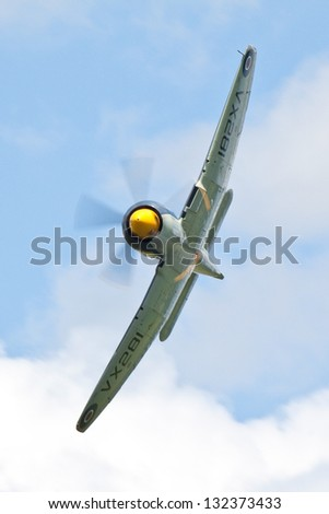 DUXFORD, CAMBRIDGESHIRE, UK - JUNE 30: Sea Fury T.20 VX281 flying on June 30, 2012 at the Duxford Legends Air Show event in Duxford, Cambridgeshire, UK. - stock photo