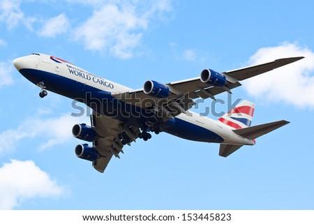 DUXFORD, CAMBRIDGESHIRE, UK - September 7: British Airways Boeing 747-8F cargo plane flying on September 7, 2013 at the Duxford Air Show at Duxford, Cambridgeshire, UK.  - stock photo
