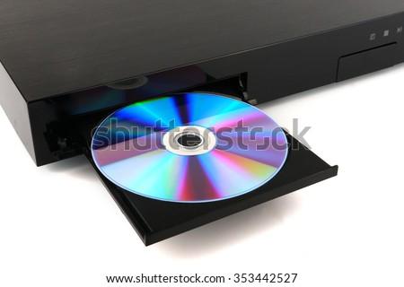 DVD, CD disk insert to dvd player - stock photo