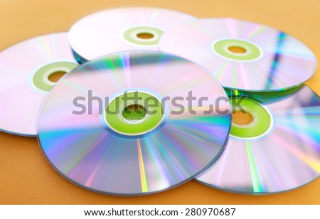 DVDs on a yellow background - stock photo