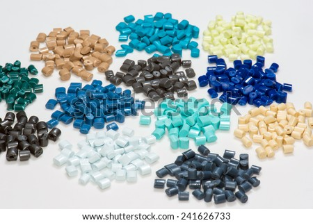 dyed plastic pellets for injection moulding process in industry - stock photo