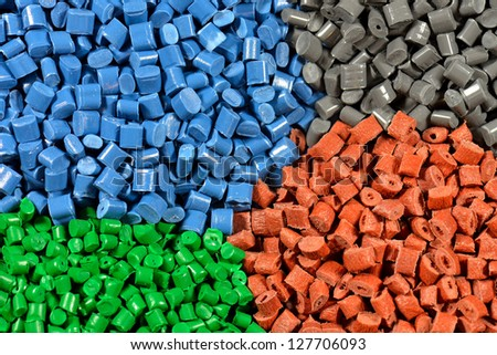 dyed polymer pellets for injection moudling process - stock photo