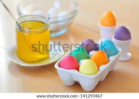 Dyeing Easter eggs - stock photo