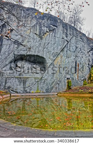 Dying Lion or Lion of Lucerne monument in Lucerne, Switzerland. Carved in the rock, it honors Swiss Guards, massacred during the French Revolution when revolutionaries stormed the Tuileries Palace - stock photo