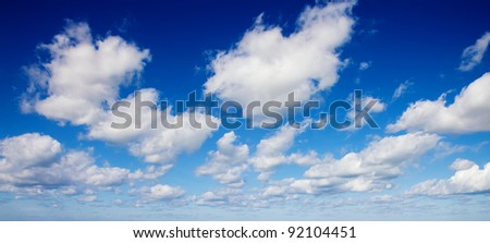Dynamic clouds panorama in blue sky, good as design element - stock photo
