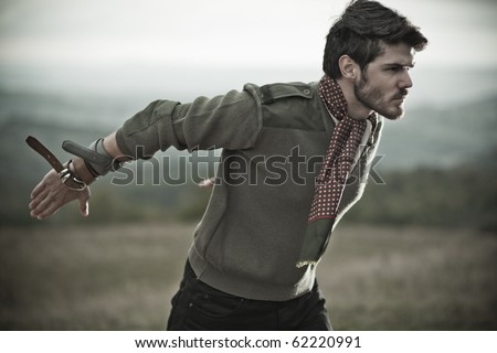 Dynamic image of a handsome male model - stock photo