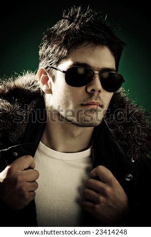 Dynamic image of a handsome young man shot in studio - stock photo