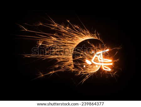 Dynamic image of football helmet in sparks on black background with copy space. - stock photo