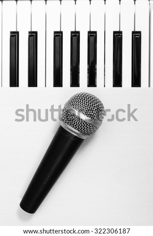 dynamic microphone on piano, B&W photo for music background - stock photo