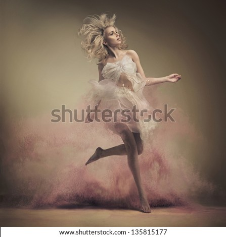 Dynamic photo of a stunning blonde beauty - stock photo
