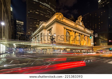 Dynamic wide angle view on the illuminated Grand Central Terminal at night with red light trails on the streets in New York, USA, America - stock photo