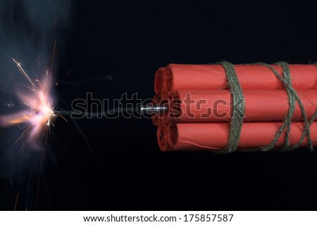 Dynamite checkers associated explosive with a burning fuse.  - stock photo