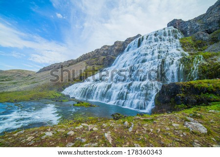 Dynjandi is the most famous and beautiful waterfall of the West Fjords in Iceland. - stock photo