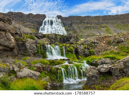 Dynjandi is the most famous and beautiful waterfall of the West Fjords in Iceland. Panorama - stock photo
