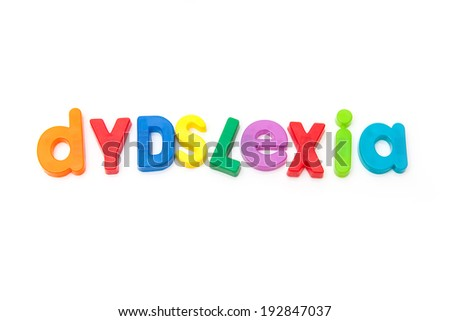 Dyslexia written in magnetic letters. on a white studio background. - stock photo