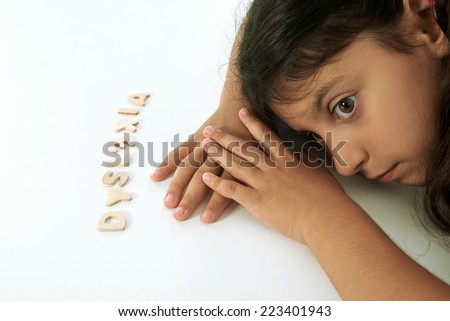 dyslexic girl thinks that is dumb. - stock photo