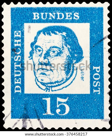 """DZERZHINSK, RUSSIA - FEBRUARY 04, 2016: A postage stamp of GERMANY shows portrait of Martin Luther, the series """"Famous Germans"""", circa 1961 - stock photo"""