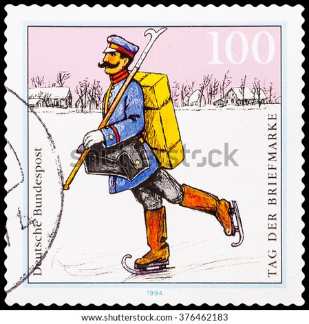 DZERZHINSK, RUSSIA - FEBRUARY 04, 2016: A postage stamp of GERMANY shows Postman. Delivery mail on ice skating. Spreewald Region, circa 1994 - stock photo