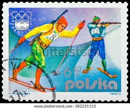 DZERZHINSK, RUSSIA - FEBRUARY 11, 2016: A postage stamp of POLAND shows biathlon and Emblem, 12th Winter Games, Innsbruck, Austria, circa 1976 - stock photo