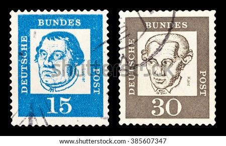 DZERZHINSK, RUSSIA - FEBRUARY 04, 2016: Set of a postage stamp of GERMANY shows portraits Martin Luther and Immanuel Kant, circa 1961 - stock photo