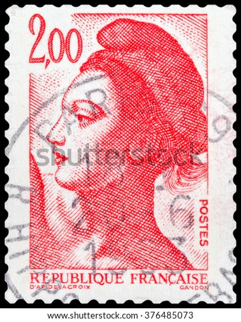 """DZERZHINSK, RUSSIA - JANUARY 18, 2016: A postage stamp of FRANCE shows Freedom with the painting """"Liberty on the barricades"""", circa 1982 - stock photo"""