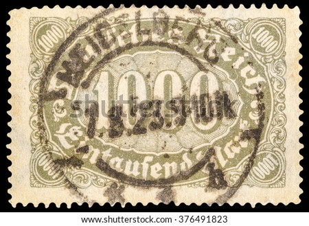 DZERZHINSK, RUSSIA - JANUARY 18, 2016: A postage stamp of GERMANY shows sign of 1000 mark, circa 1923 - stock photo