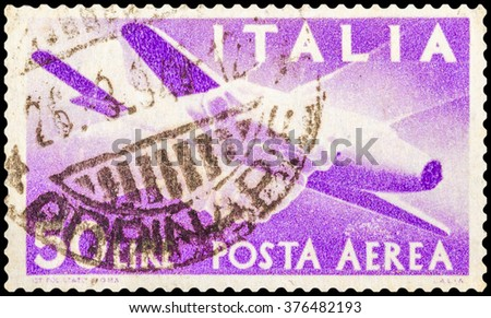 DZERZHINSK, RUSSIA - JANUARY 18, 2016: A postage stamp of ITALY shows Plane and Clasped Hands, circa 1947 - stock photo