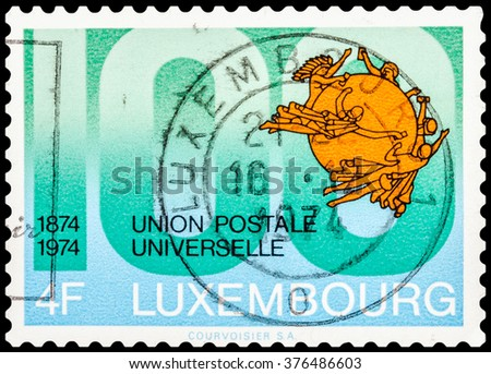 DZERZHINSK, RUSSIA - JANUARY 18, 2016: A postage stamp of LUXEMBOURG shows union postale universelle, circa 1974 - stock photo