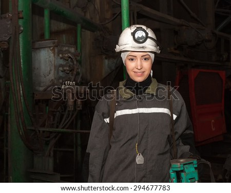 Dzerzhinsk, Ukraine - March 03, 2014: Young woman - surveyor before the descent into the underground workings. Mine is named Saint Matrona of Moscow - stock photo