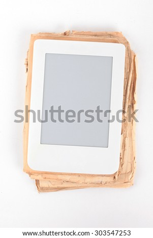 E-book on the background of old paper book - stock photo