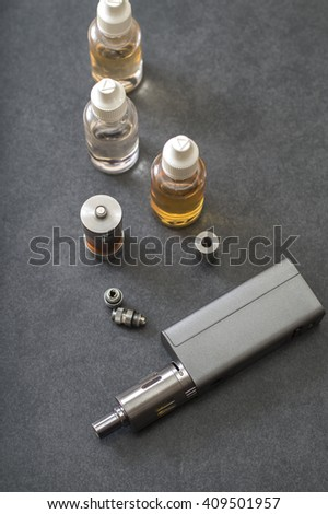 e-cigarettes with lots of different re-fill bottles, from above - stock photo