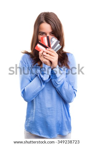 E-commerce concept - Happy woman holding credit cards - stock photo